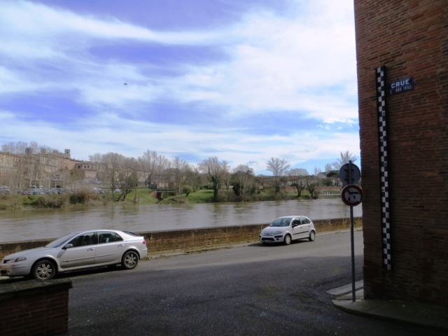 Montauban - River Tarn. The marker on the building shows how high the river rose in March 1930