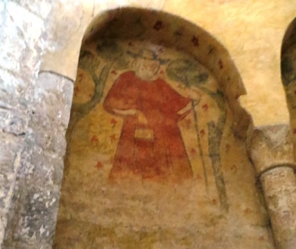 Wall painting depicting a pilgrim with a rather natty handbag