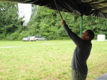Removing the rain from the tarpaulin