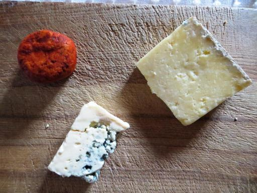 The remnants of last night's cheese board: Maroilles coated in paprika, Laguiole and Bleu d'Auvergne