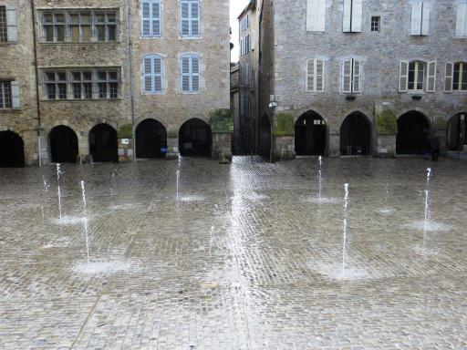 New fountain in market square at Villefranche-de-Rouergue - on a wet and blustery Feb day