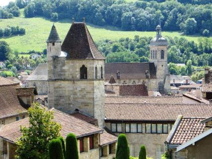 The churches and rooftops of Figeac with the hillside above the Célé beyond