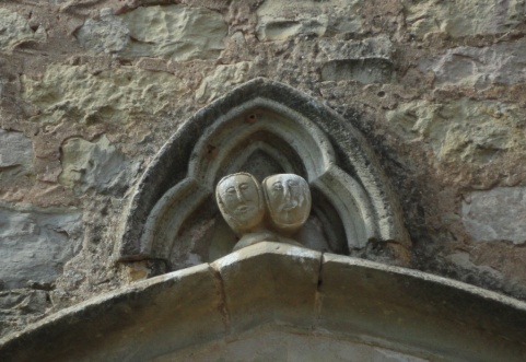 Carved figures above the church door