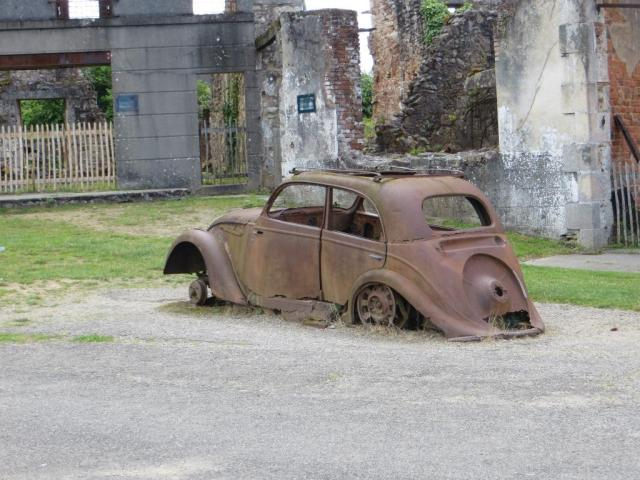 Abandoned car at the entrance to the square where the villagers were penned in