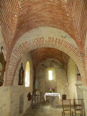 Church interior with brick-faced ceiling