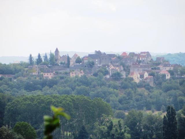 Calvignac taken from the Château de Cénevières on a hazy day