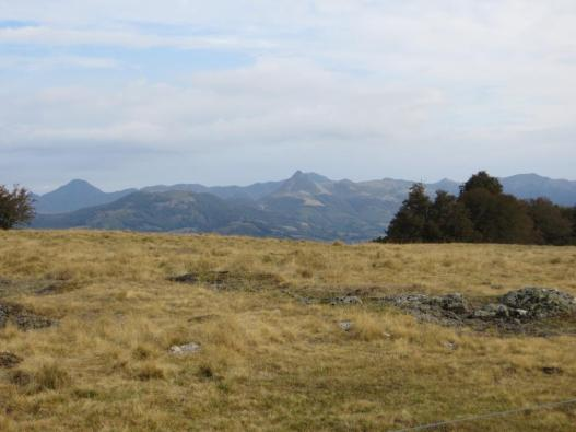 Monts de Cantal glimpsed from one of our walks. The conical mountain in the middle is the Puy Griou