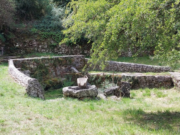 Pond surrounded by stone walls in SW France