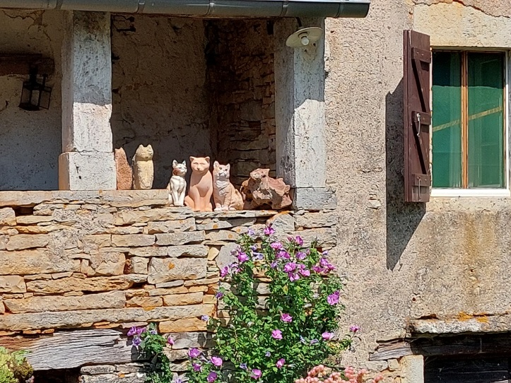 Pottery cats on a balcony in SW France
